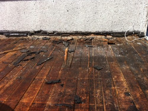 Rotten deck against house